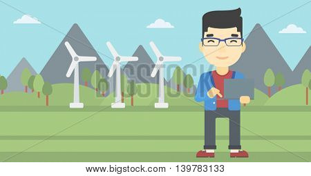 An asian man holding a laptop hands on a background with solar pannels and wind turbins. Man working on computer. Vector flat design illustration. Horizontal layout.