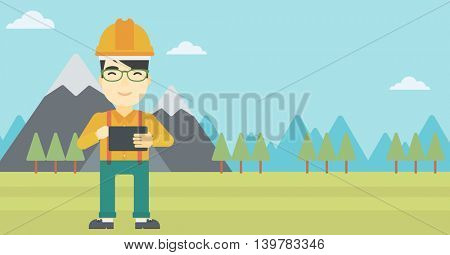 An asian man in hardhat holding a tablet computer in hands on the background of mountain landscape. Man working on digital tablet. Vector flat design illustration. Horizontal layout.