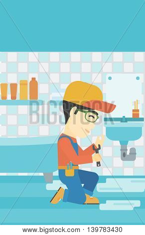 An asian plumber sitting in a bathroom and repairing sink pipe. Plumber with wrench repairing a broken sink in bathroom. Vector flat design illustration. Vertical layout.