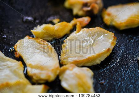 Close up photography of roasted meat slices on skillet