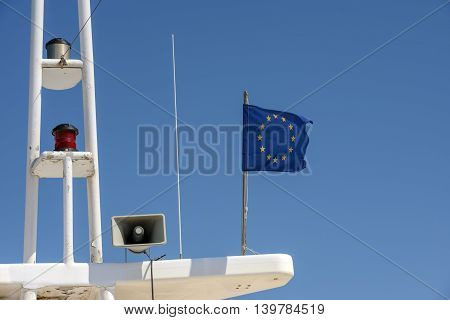 Eu Flag Is On Mast Console On Yacht Deck House.