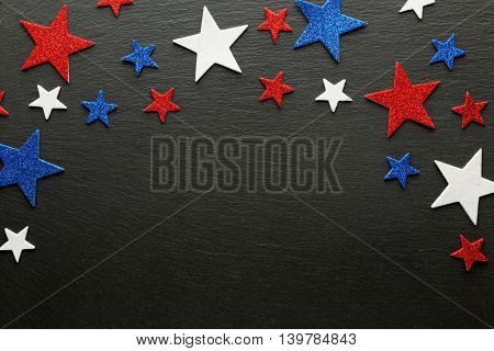 Red, white, and blue stars on slate background