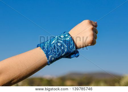 Hand With Fist And Blue Bandana