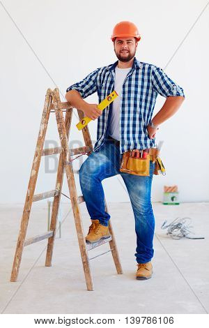 Portrait Of Confident Foreman, Professional Near Ladder
