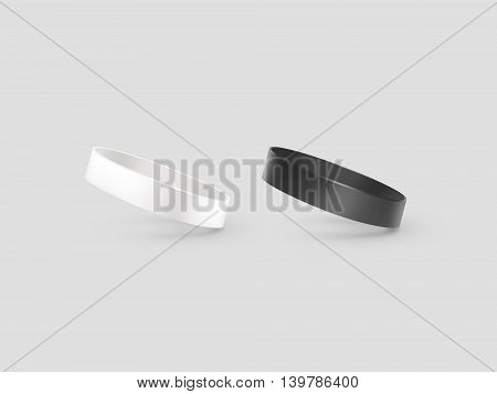 Blank white and black rubber wristband mockup clipping path 3d illustration. Clear sweat band mock up design. Sport sweatband template. Silicone fashion round social bracelet. Unity band.