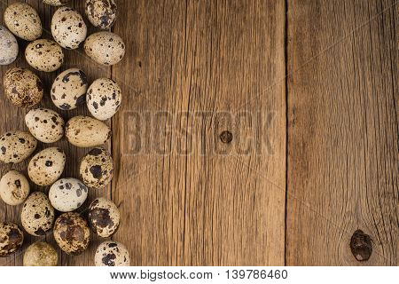 quail eggs.Texture of wood background closeup.quail eggs.Texture of wood background closeup