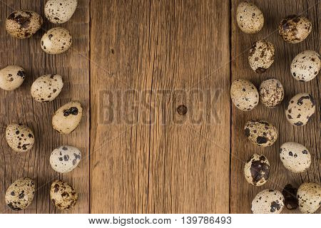 quail eggs.quail eggs.Texture of wood background closeup