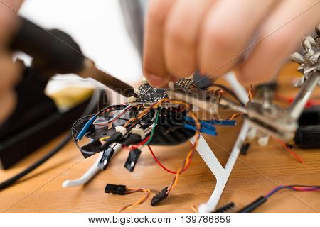 Man welding the accessories on drone body