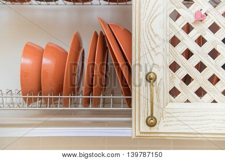 Beautiful clean dishes in rustic kitchen cupboard