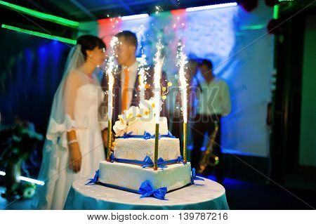 wedding cake with fireworks at wedding day
