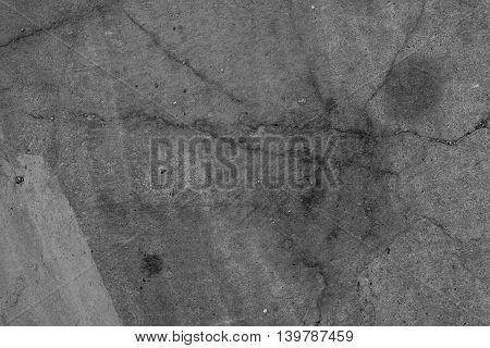 Cracks in concrete flooring weathered urban texture