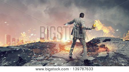 Businessman throwing petrol bomb . Mixed media