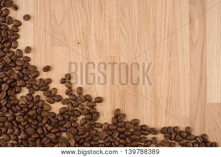 Coffee beans on wood background. Texture of wood background closeup