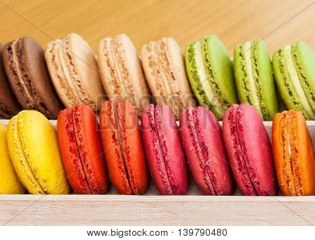 Row Of Traditional French Colorful Macarons In A Box