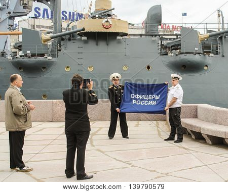 St. Petersburg, Russia - 16 July, Officers photographed against the backdrop of the cruiser