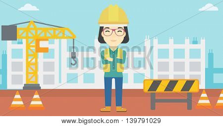 An asian female builder with arms crossed. Confident builder on a background of construction site. Builder in helmet on background of road works. Vector flat design illustration. Horizontal layout.