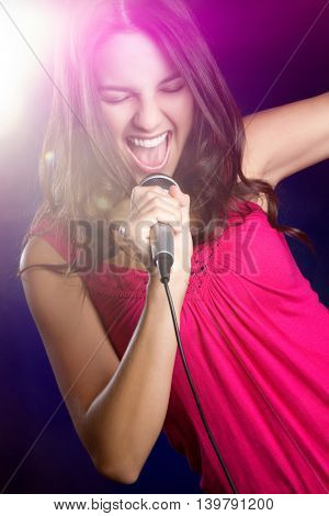 Pretty teen girl singing karaoke