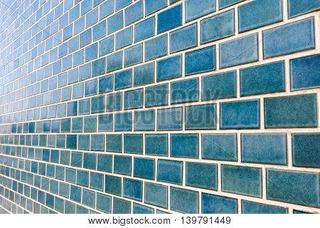 Pattern of shiny blue brick wall background.
