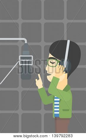 An asian man in headphones singing in recording studio. Singer making a record of his voice. Young singer recording a song. Vector flat design illustration. Vertical layout.