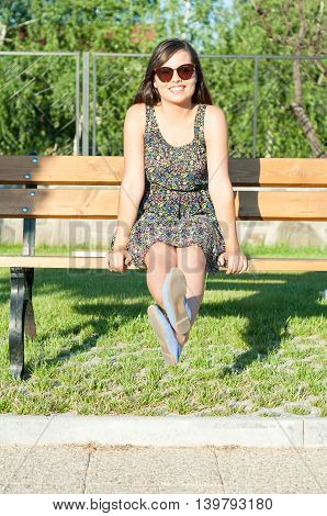 Beautiful Girl Smiling And Being Cheerful On Bench