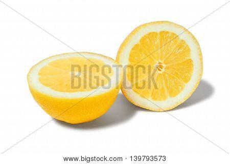 Two halves of lemon on white background