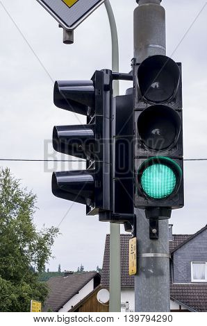 Green light at traffic lights. Germany. City.