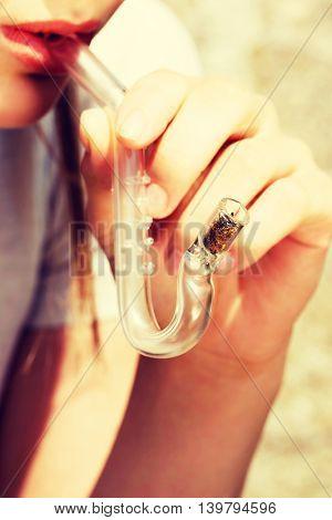 Teen Girl smoking cannabis