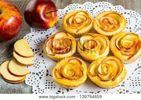 Puff apple shaped roses muffins. Sweet apple dessert pie. Homemade apple rose pastry.