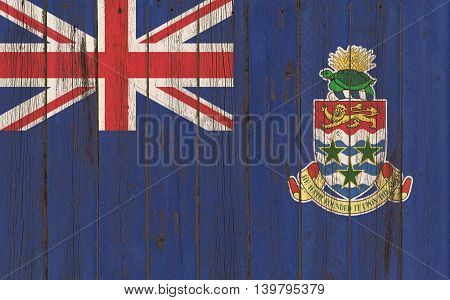 Cayman Islands flag on old wood texture background