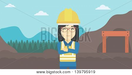 An asian confident coal miner. Female miner standing in front of a big mining equipment on the background of coal mine. Vector flat design illustration. Horizontal layout.