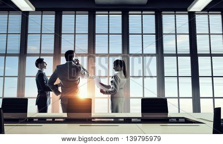Silhouettes of Business People in Office. Mixed media . Mixed media