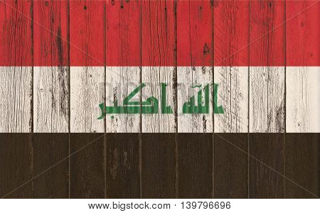 Flag of Iraq painted on wooden frame