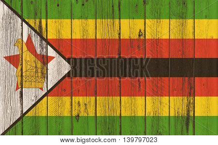Flag of Zimbabwe painted on wooden frame