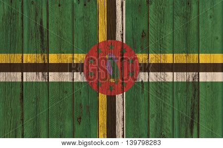 Flag of Dominica painted on wooden frame