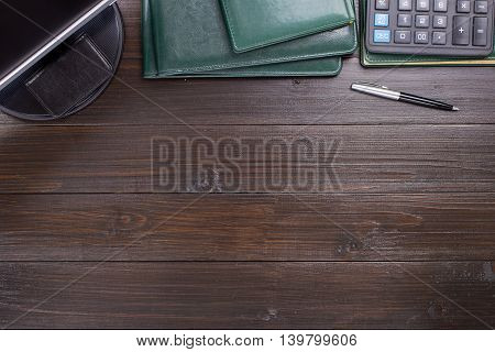 Diary Pen Monitor Leather Folders And Calculator On A Wooden Office Desk. Office Desktop With Copy Space Top View