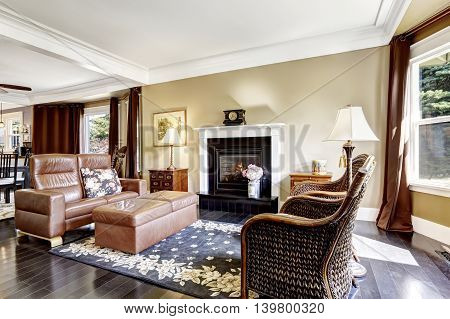 Luxury Home Interior With Fireplace, Antique Chairs And Leather Couch