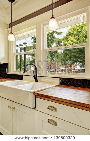 Kitchen Interior In White Tones With Hardwood Counter Top.
