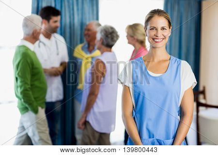 Nurse standing in front of seniors in a retirement home