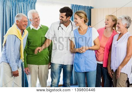 Nurse and seniors standing together in a retirement home