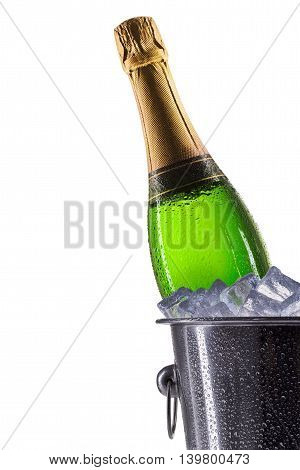 Metal champagne ice bucket with champagne isolated on a white background.