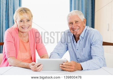 Senior couple using a tablet in a retirement home