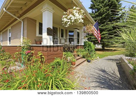 American Craftsman House Exterior. Cozy Covered Porch With White Columns.