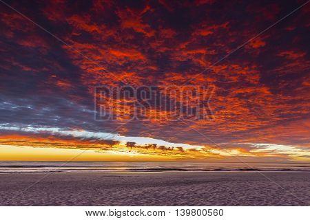 Colourful cloudscape sunrise over ocean and Currumbin Beach Gold Coast
