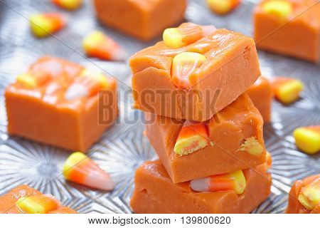 Delicious butterfinger fudge with candy corn and peanut butter