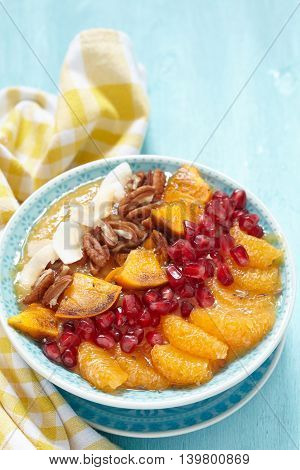 Smoothie with clementine, persimmon, pomegranate and pecan