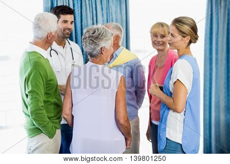 Nurses talking with seniors in a retirement home