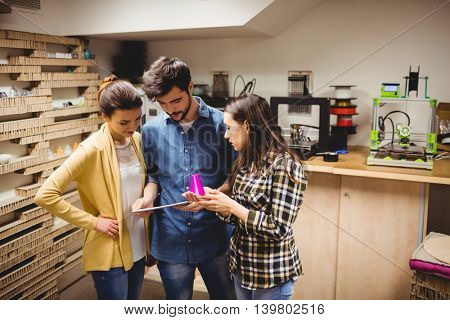 Team of graphic designers interacting using digital tablet in office