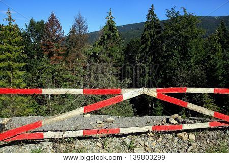 Damaged landslides asphalt road on canvas mountain pass.