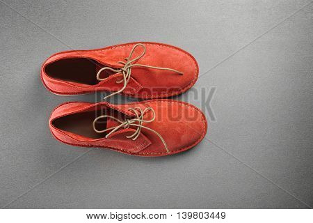 Red shoes on grey background