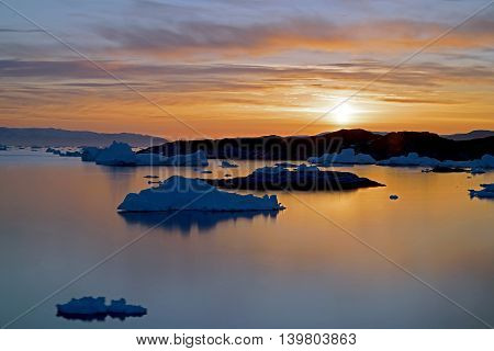 Huge icebergs are on the arctic ocean in Ilulissat fjord, Greenland